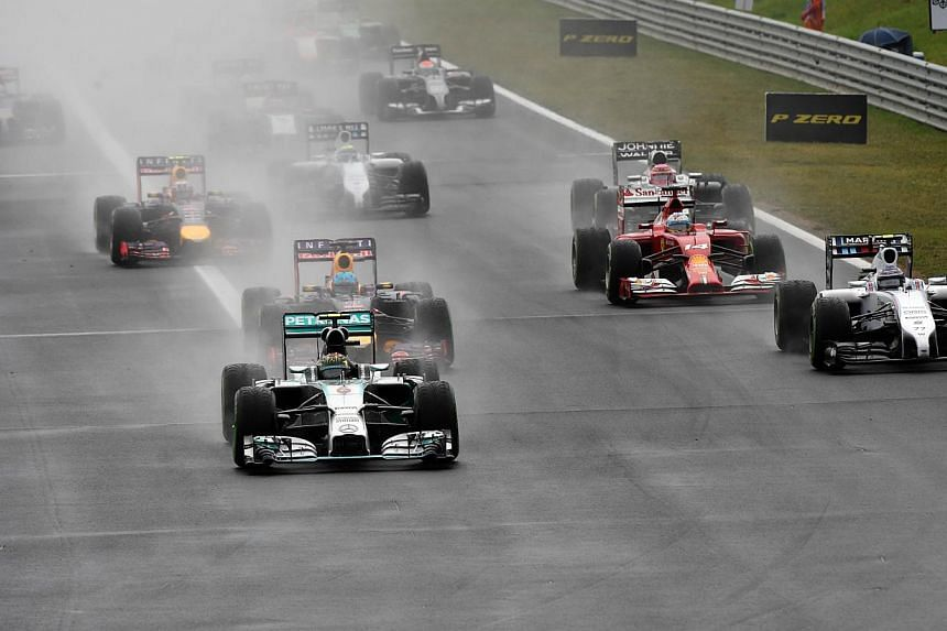 Drivers race at the start of the Hungarian Formula One Grand Prix at the Hungaroring circuit in Budapest on July 27, 2014. -- PHOTO: AFP
