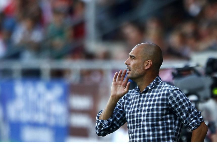 Bayern Munich will never push out their coach Pep Guardiola (above), club chief executive Karl-Heinze Rummenigge said in an interview published on Sunday, July 27, 2014. -- PHOTO: REUTERS