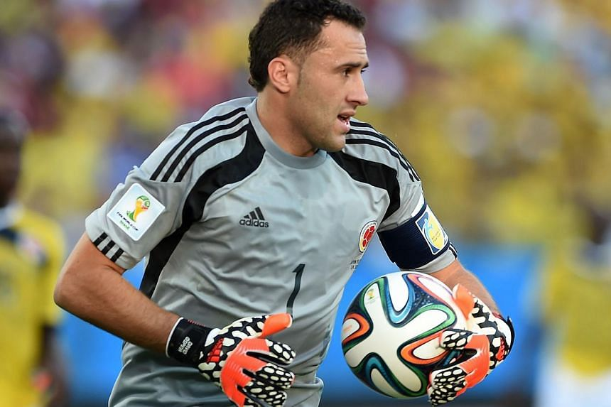 Colombia's goalkeeper David Ospina clears the ball during a Group C football match between Japan and Colombia at the Pantanal Arena in Cuiaba during the 2014 FIFA World Cup on June 24, 2014.  English Premier League side Arsenal said on Sund