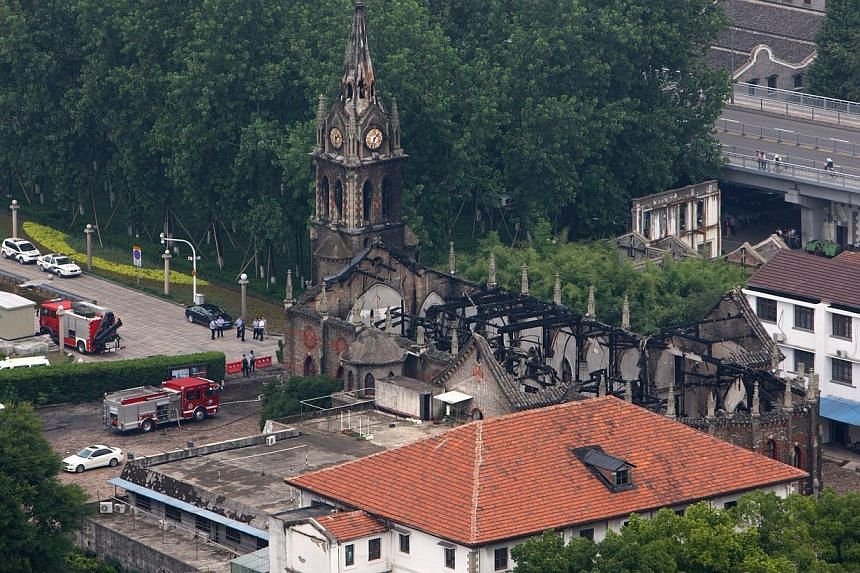 This overhead view shows firetrucks (bottom left) beside the Ningbo cathedral as firefighters put out a fire at the structure in Ningbo, in eastern China's Zhejiang province on Monday, July 28, 2014.A fire largely destroyed one of China's oldes