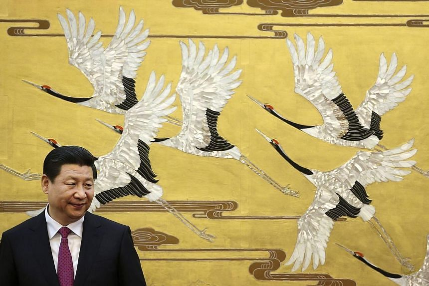 Chinese President Xi Jinping's name has graced the pages of the Communist Party's flagship newspaper more frequently than any other leader since founding father Mao Zedong, according to researchers. -- PHOTO: REUTERS