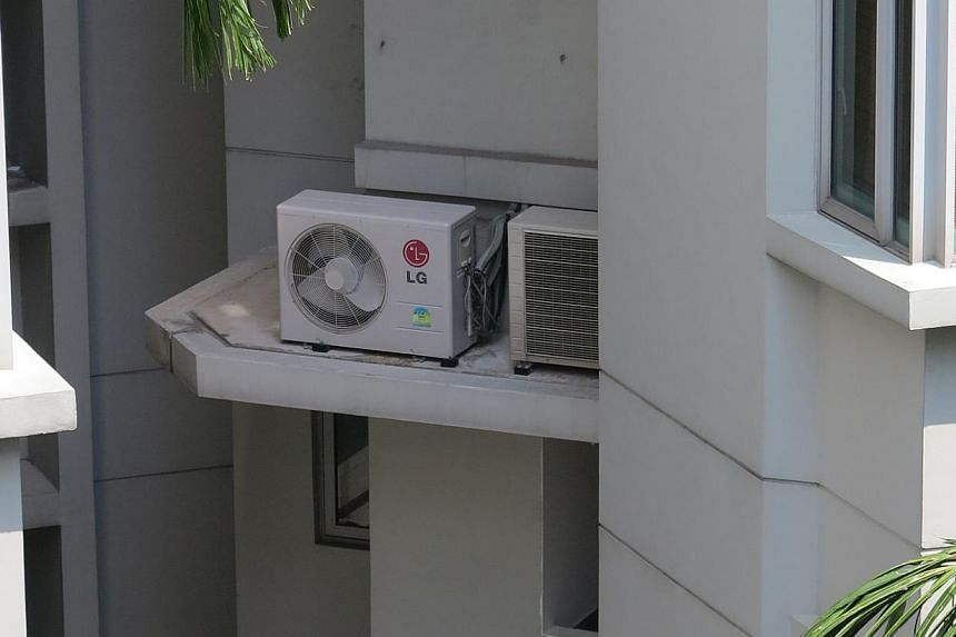 Ledges for air-conditioning condenser units collect water easily and many are inaccessible to residents for cleaning. Flat roofs, such as this one over a petrol station, can trap rain water and make it a prime breeding spot for mosquitoes. Ground spo