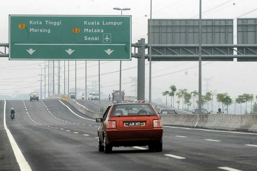 Vehicles travelling along the new Eastern Dispersal Link (EDL) highway in Johor Baru.At least 180,000 vehicles or about 80 per cent of Eastern Dispersal Link (EDL) motorists would not have to pay toll rates as they could exit at various points