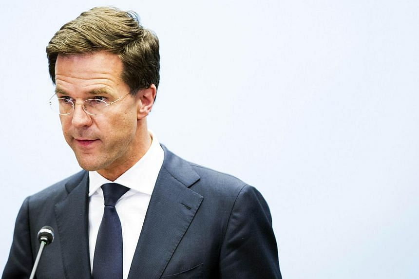 Dutch Prime Minister Mark Rutte addresses the press in The Hague, the Netherlands, on July 24, 2014, regarding Malaysia Airlines flight MH17 which crashed in eastern Ukraine. -- FILE PHOTO: AFP