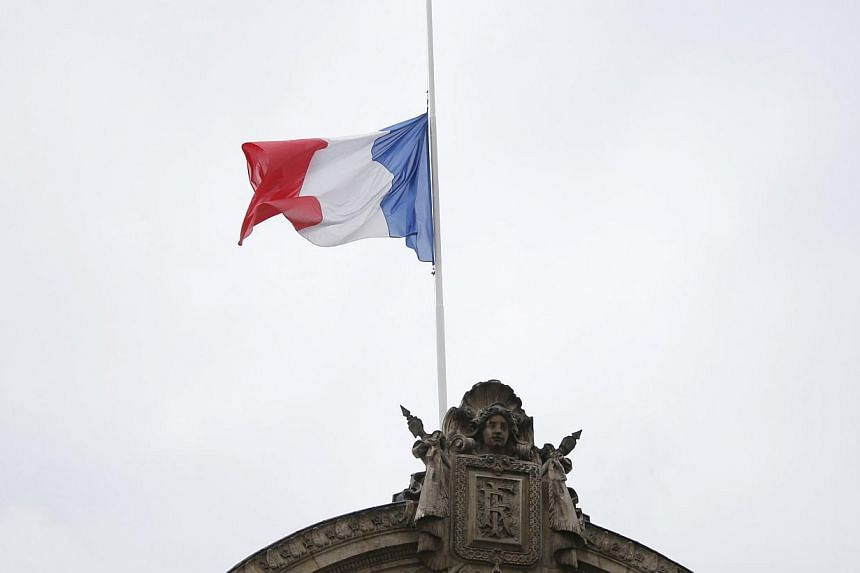 Flags flew at half-mast in France on Monday, July 28, 2014, in mourning for the 118 victims of the Air Algerie plane tragedy, as investigators waited for the black boxes from the crash to arrive. -- PHOTO: AFP