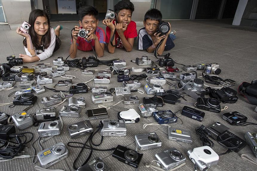An ongoing collection drive of old cameras to allow disadvantaged children to own their first set of lens has received more than 120 cameras.-- PHOTO:THE PEOPLE'S ASSOCIATION