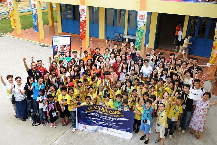 Photo outing held on 19 July 2014.An ongoing collection drive of old cameras to allow disadvantaged children to own their first set of lens has received more than 120 cameras.-- PHOTO:THE PEOPLE'S ASSOCIATION