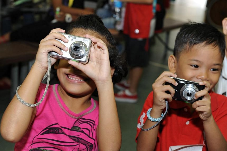An ongoing collection drive of old cameras to allow disadvantaged children to own their first set of lens has received more than 120 cameras. -- PHOTO:THE PEOPLE'S ASSOCIATION
