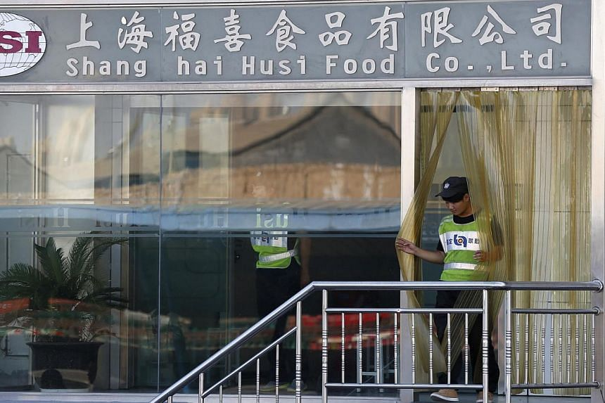 A man walks out of the entrance of Husi Food factory in Shanghai on July 23, 2014.An on-going internal investigation conducted by OSI Group LLC into its unit, the scandal-hit Chinese food supplier Shanghai Husi Food Co Ltd, has revealed that st