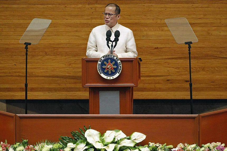 Philippine President Benigno Aquino delivers his fifth State of the Nation Address (SONA) during the joint session of the 16th Congress at the House of Representatives of the Philippines in Quezon city, metro Manila on Monday, July 28, 2014.Phi
