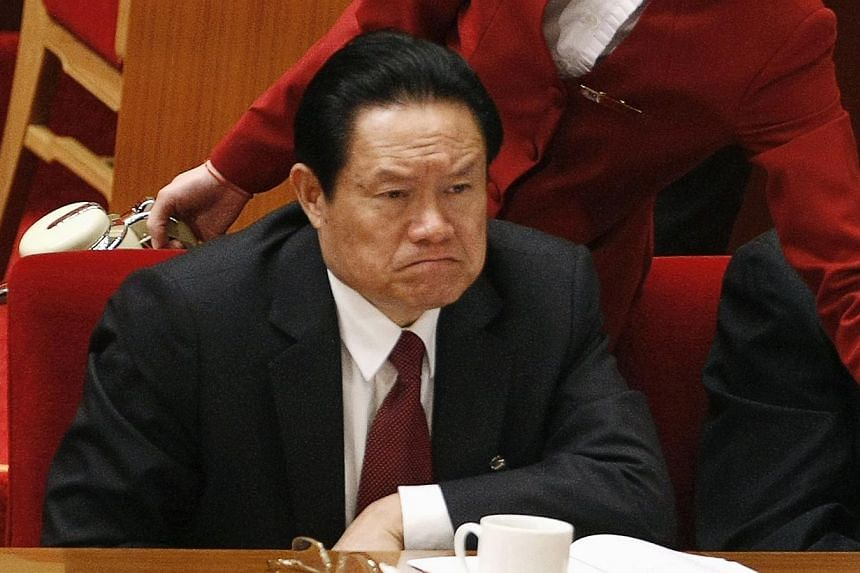 China's then Public Security Minister Zhou Yongkang attends the opening ceremony of the 17th National Congress of the Communist Party of China at the Great Hall of the People, in Beijing in this October 15, 2007 file photo.Embattled former top