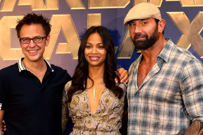 (From left) Director James Gunn, actress Zoe Saldana and former wrestler Dave Bautista, at the press conference in Singapore on 10 July 2014 to promote their upcoming Marvel superhero flick, Guardians Of The Galaxy. -- PHOTO: TNP