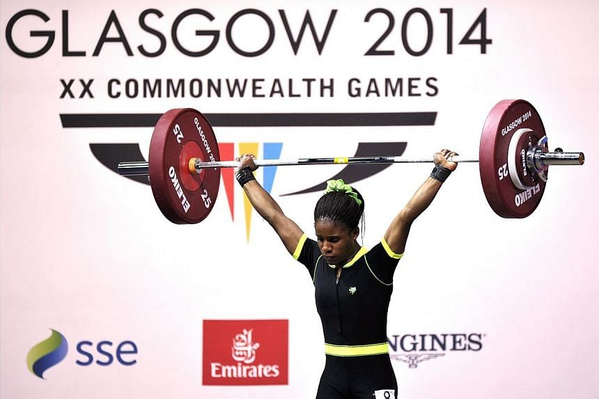 Nigeria's gold medalist Chika Amalaha competing in the women's weightlifting 53kg class, at the SECC Precinct during the 2014 Commonwealth Games in Glasgow, Scotland on July 25, 2014. -- PHOTO: AFP