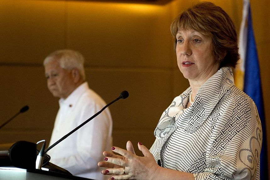 Vice president of the European Commission (EC) and high representative of the European Union (EU) for foreign affairs and security policy, Catherine Ashton (rght), speaks during a press conference with Philippine Foreign Affairs Secretary Albert Del