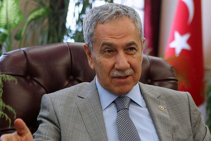 Turkey's Deputy Prime Minister Bulent Arinc speaks to the press ahead of the presidential elections in Ankara on July 24, 2014. Mr Arinc, one of the most senior members of Turkish Prime Minister Recep Tayyip Erdogan's government, sparked an outcry on