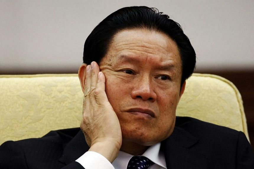 China's then Public Security Minister Zhou Yongkang reacts as he attends the Hebei delegation discussion sessions at the 17th National Congress of the Communist Party of China at the Great Hall of the People in Beijing on Oct 16, 2007.China's f