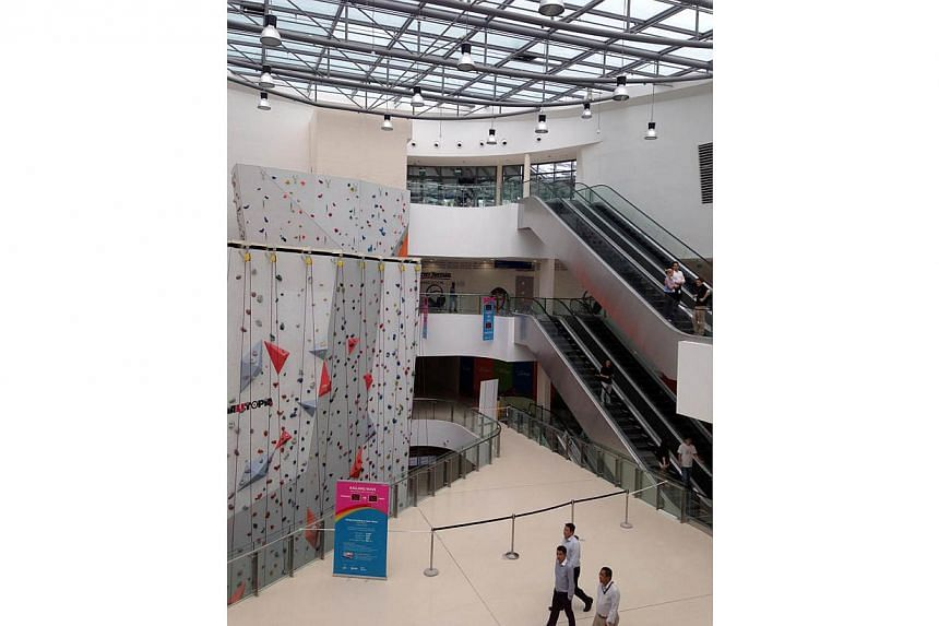 Climbing activities at the indoor rock-climbing wall in Kallang Wave Mall have been suspended. This is believed to be due to cracks in the glass ceiling just above the facility. -- ST PHOTO: JAMIE KOH