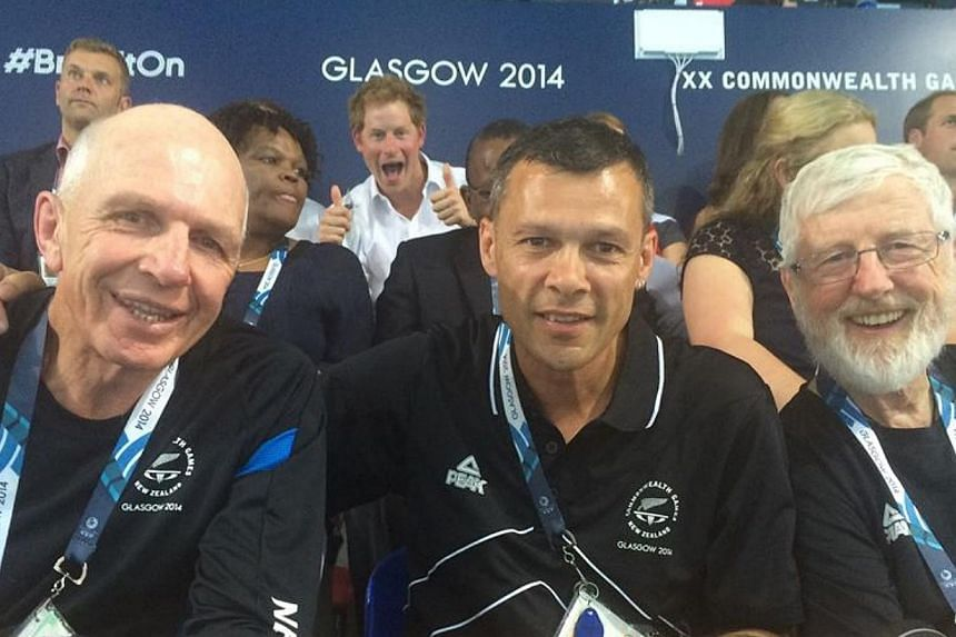 Britain's Prince Harry has followed his grandmother Queen Elizabeth II into the photobomb craze, giving the thumbs up in an image of acclaimed New Zealand rugby sevens coach Gordon Tietjens at the Commonwealth Games. --PHOTO: TREVOR SHAILER/FAC