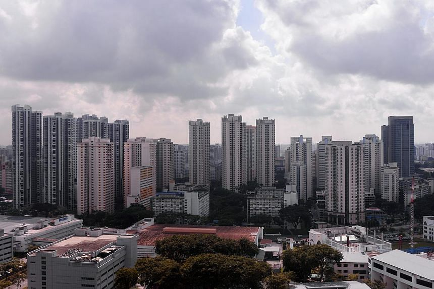 Resale prices of private homes reverted to their declining trend last month, falling 1 per cent from May, according to the latest Singapore Residential Price Index (SRPI) released on Tuesday. -- PHOTO: ST FILE