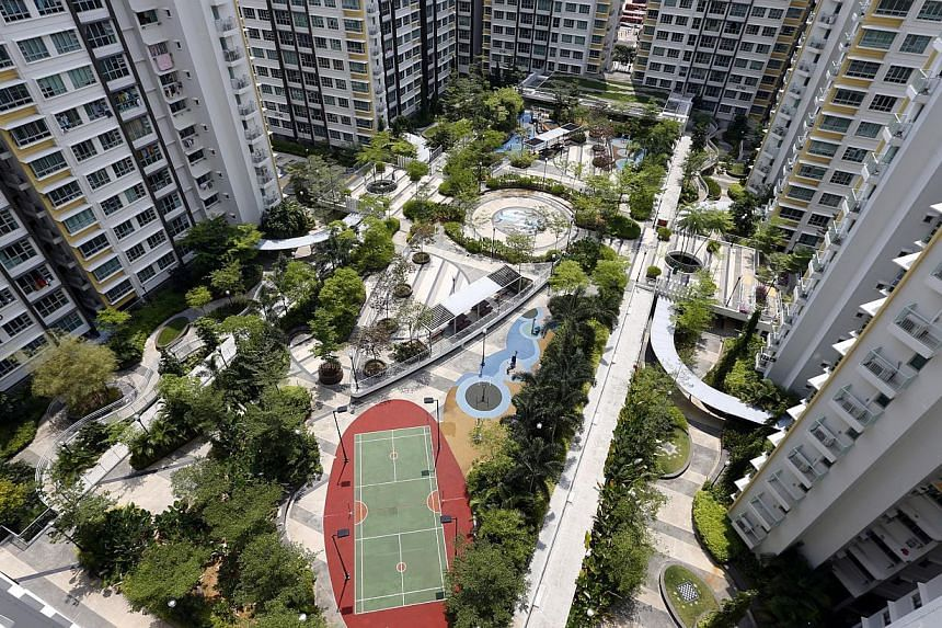 "The green and red rooftop ""carpet"" in Toa Payoh West (above) is made up of small, interlocking plastic trays - a system developed by the HDB itself. This rooftop is not accessible to the public, but some, such as the one in Punggol Place (below), inc"