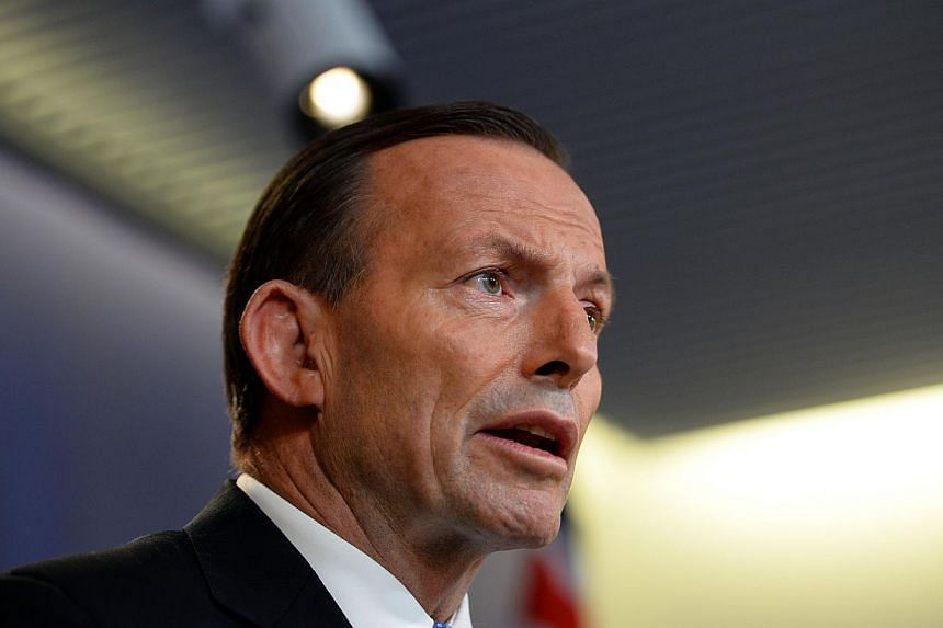 Australian Prime Minister Tony Abbott speaks at a press conference in Sydney on July 19, 2014.Embattled Australian Prime Minister Tony Abbott's forthright handling of the downing of Malaysia Airlines Flight MH17 appears to have paid off, a poll