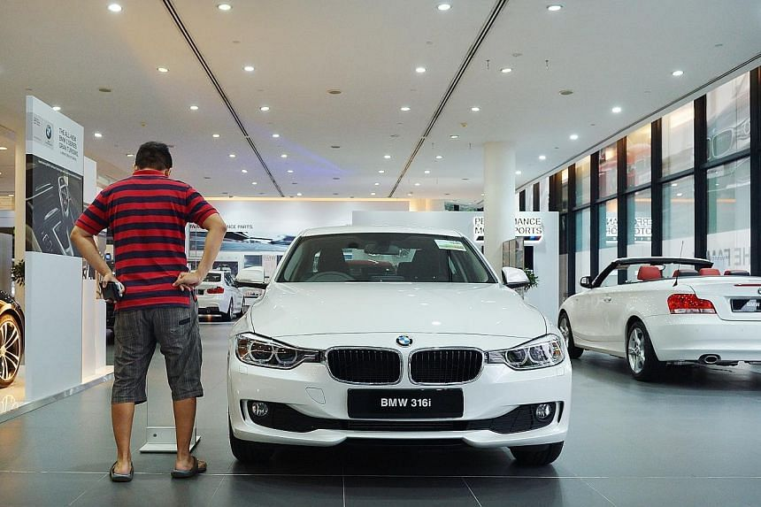 The new COE classification was meant to level the playing field for sellers of mass-market cars, who in recent years have been edged out of Category A by luxury brands such as Mercedes-Benz and BMW (above). -- PHOTO: ST FILE
