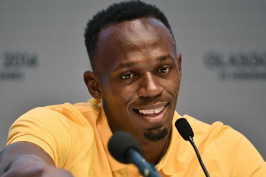 Jamaica's sprinter Usain Bolt speaks during a press conference at the 2014 Commonwealth Games in Glasgow, Scotland, on July 26, 2014. Jamaica might not have had Usain Bolt on the starting blocks, but track's biggest star was quick to laud teamma