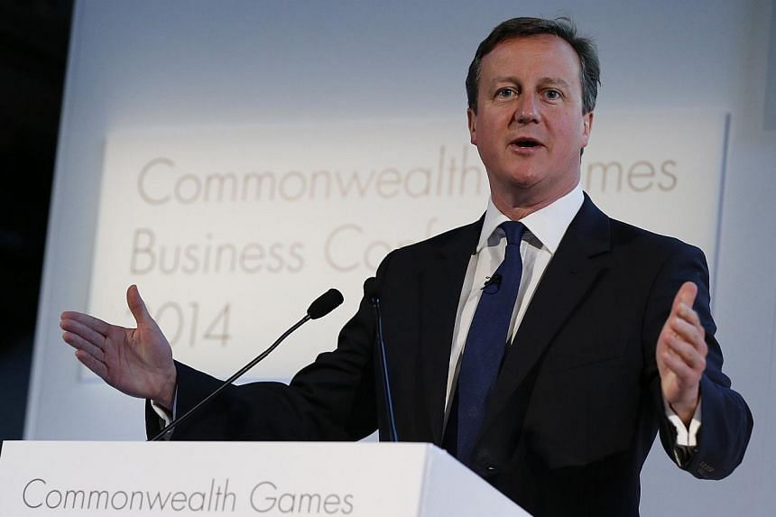 Britain's Prime Minister David Cameron speaks at the Commonwealth Games Business Conference in Glasgow, Scotland, July 23, 2014. Britain's prime minister announced new measures to cut immigration on Tuesday in a bid to lure voters from eurosceptic ri