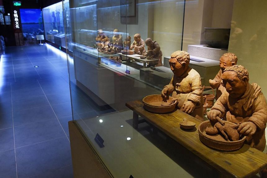 Clay figures portraying the production of Peking Duck in the museum at the Quanjude restaurant in Beijing. -- PHOTO: AFP