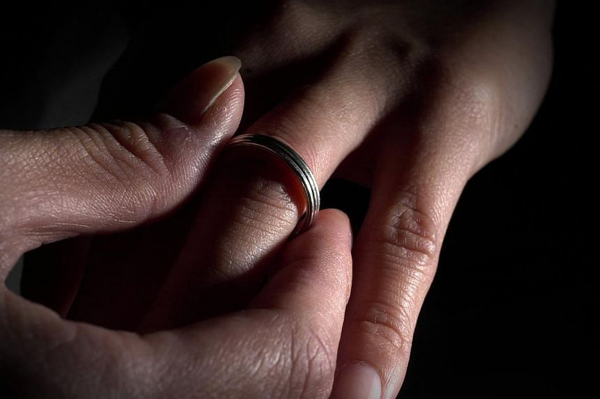 There were more divorces and annulments last year, even as fewer couples tied the knot, according to the Statistics on Marriages and Divorces 2013 report released on Tuesday, July 29, 2014. -- PHOTO: ST FILE