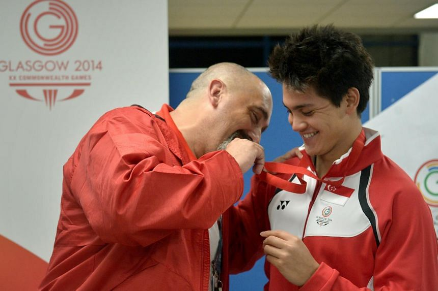 Joseph Schooling makes history by winning a silver medal, the first ever medal in swimming at the Commonwealth Games, in the 100m butterfly at the Tollcross International Swimming Centre on July 28, 2014.. -- ST PHOTO:KUA CHEE SIONG