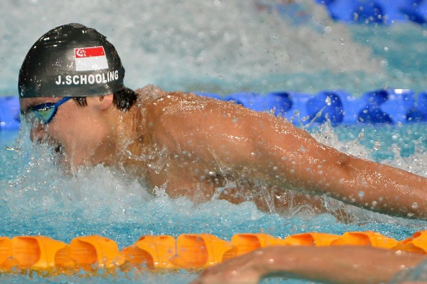 Joseph Schooling makes history by winning a silver medal, the first ever medal in swimming at the Commonwealth Games, in the 100m butterfly at the Tollcross International Swimming Centre on July 28, 2014.. -- ST PHOTO: KUA CHEE SIONG