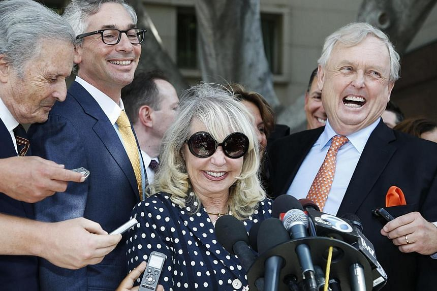 Shelly Sterling, 79, (2nd right) speaks at a news conference with her lawyer Pierce O'Donnell (right) and Steve Ballmer's lawyer Adam Streisand (2nd left) in Los Angeles, California on July 28, 2014.A US judge on Monday gave the go-ahead for th