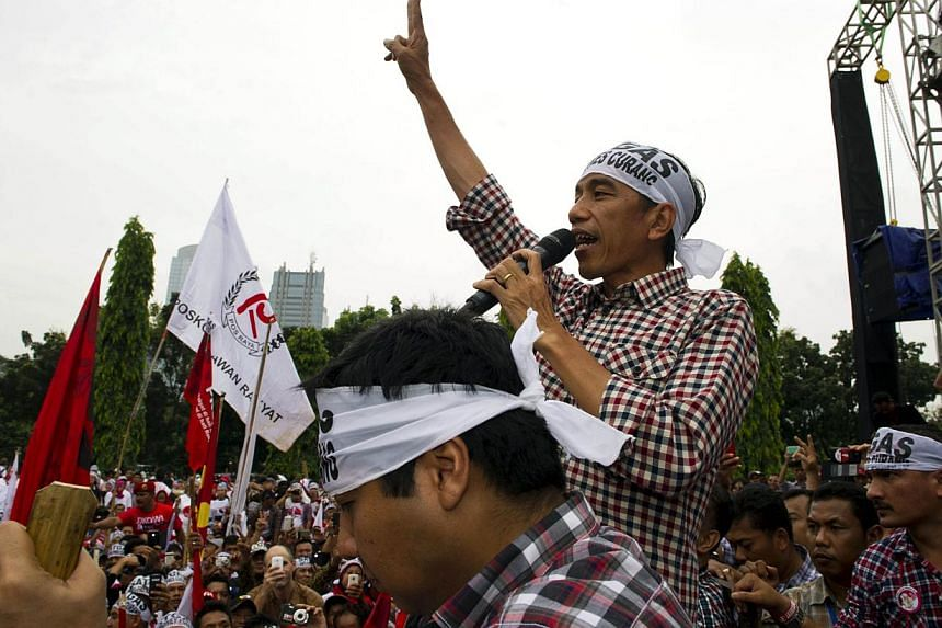 Indonesian president-elect Joko Widodo addresses supporters during a campaign rally in Jakarta on June 26, 2014. He is the only Indonesian politician in years to connect with people in a political culture more accustomed to top-down leadership.