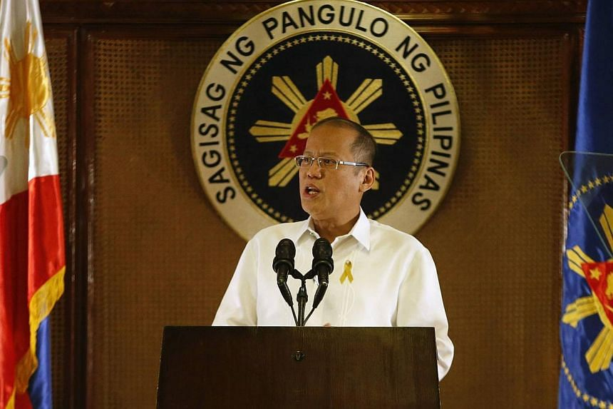 Philippine President Benigno Aquino addresses the nation in a live broadcast at the presidential Malacanang Palace in Manila, July 14, 2014. Mr Aquino sought on Wednesday to quash rumours that a coup is being plotted against him, with his spokesman i