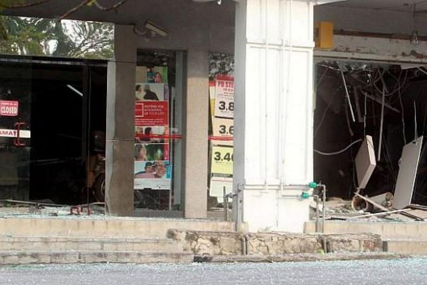 Robbers attempting to blast open an ATM at a bank in the quiet town of Bukit Beruntung brought down the ceiling at its service area and damaged several other machines. And, they got nothing. -- PHOTO: THE STAR/ASIA NEWS NETWORK