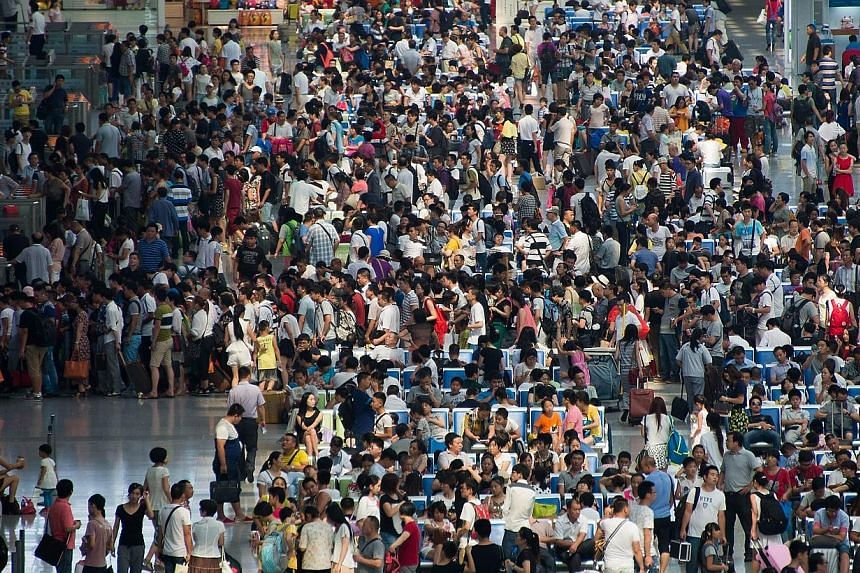 Passengers pack the waiting hall at Hongqiao Railway Station which services terminal two at Shanghai Hongqiao International Airport on July 29, 2014.Faced with snaking queues at immigration, overflowing baggage carousels and expensive flight de