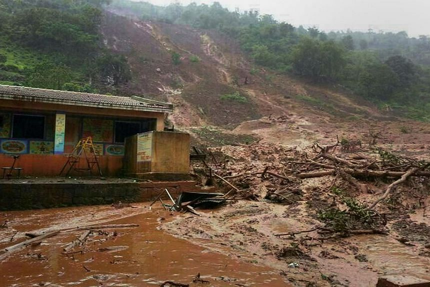 A mudslide surrounds a building in Malin village in Pune district in the western Indian state of Maharashtra on July 30, 2014. -- PHOTO: AFP