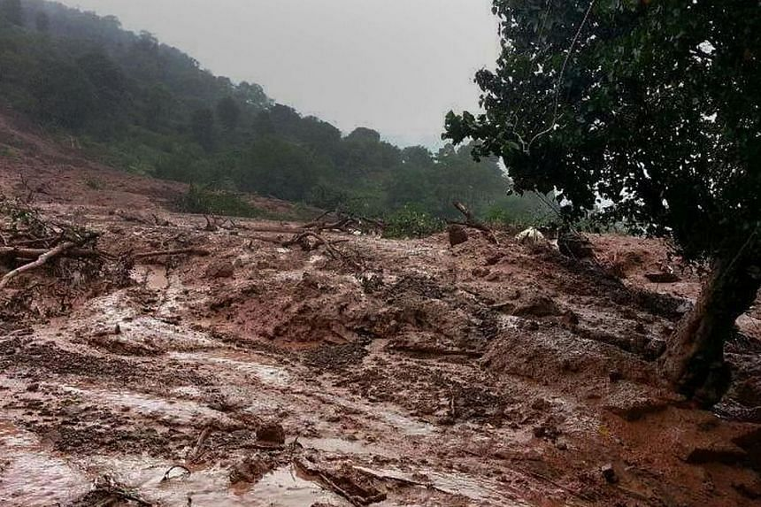 A major landslide on Wednesday struck a village in western India following heavy monsoon rains, killing at least 17 people and leaving up to 200 feared trapped, an official said. -- PHOTO: AFP