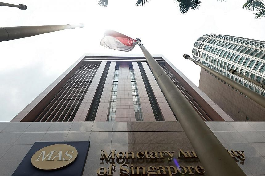 The Monetary Authority of Singapore (MAS) announced on Wednesday that it has discussed the parameters for the sale of such products with industry players and other stakeholders for the past 10 months.-- ST PHOTO: NG SOR LUAN