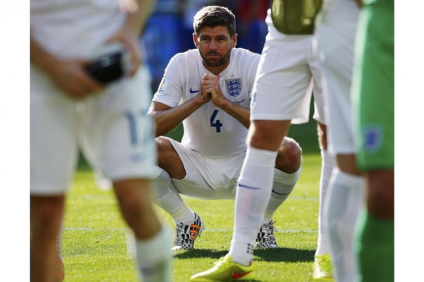 """Steven Gerrard says the slip that arguably ended Liverpool's title hopes and England being knocked out of the football World Cup in the group stage have contributed to what has been """"probably the worst three months of my life"""". -- PHOTO: REUTERS"""