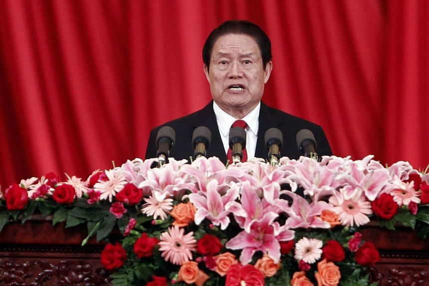 This picture taken on May 18, 2012 shows then-Politburo standing committee member, secretary of the central political and law commission, Mr Zhou Yongkang, delivering a speech at a meeting in Beijing. -- PHOTO: AFP