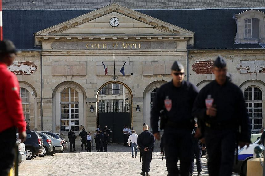 Police officers secure the entrance of the Appeal Court of Versailles for the arrival of vehicles transporting Mehdi Nemmouche, 29, the French national who is suspected of the shooting attack in the Brussels Jewish Museum last month that left four pe
