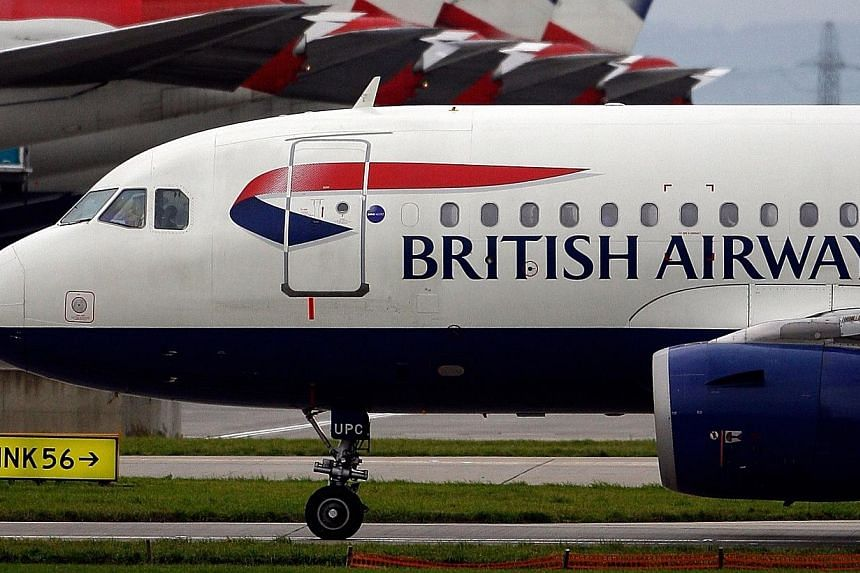 A British Airways aircraft taxis past a row of British Airways jets at Terminal 5 of Heathrow airport in London, UK on Friday, Nov 5, 2010.Girls and young women who allege they were sexually abused by a British Airways (BA) pilot in African sch
