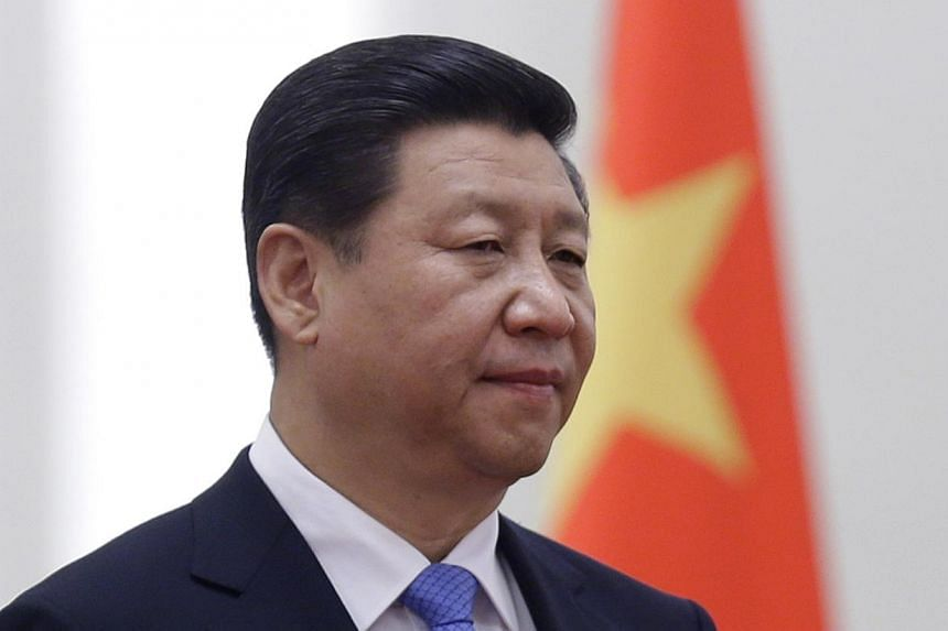 China's President Xi Jinping stands next to a Chinese national flag during a welcoming ceremony at the Great Hall of the People, in Beijing on Nov 13, 2013. Mr Xi is emerging as the country's most powerful leader in decades, analysts said, after the
