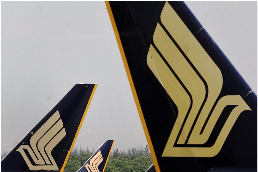Singapore Airlines said on Wednesday, July 30, 2014, its financial first quarter net profit plunged 71.4 per cent from the previous year, weighed down by lower passenger and cargo revenue. -- PHOTO: ST FILE