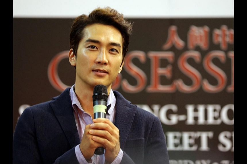 South Korean actor Song Seung Heon in Singapore on July 25, 2014 to promote his movie, Obsessed.  -- ST PHOTO: CHEW SENG KIM