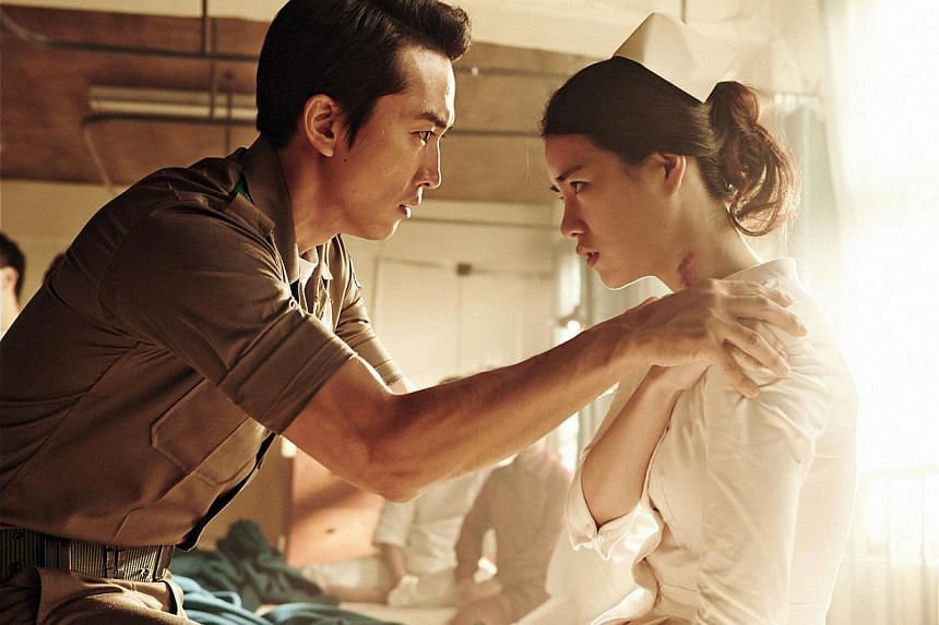 Song Seung Heon plays a decorated war hero who falls in love with his subordinate's wife (Lim Ji Yeon, both above) in Obsessed.