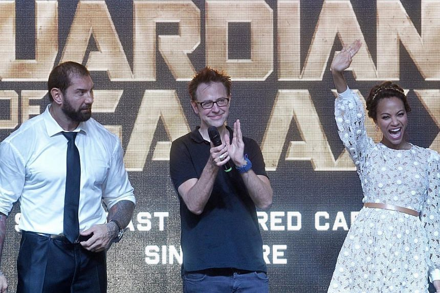 (From left) WWE wrestler Bautista, director James Gunn and Saldana were in Singapore last month for a cast visit. -- PHOTO: KEVIN LIM