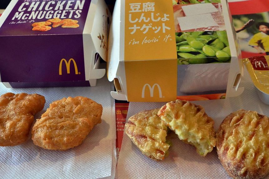 """McDonald's Japan's new tofu products """"Tofu Shinjo Nuggets"""" (right) and Chicken McNuggets (left) are displayed at a McDonald's restaurant in Tokyo on July 30, 2014. The fast-food giant's more than 3,000 restaurants in Japan started selling new tofu nu"""